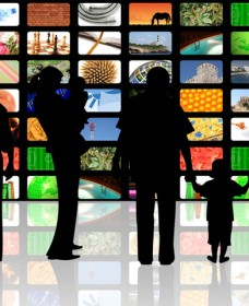 young people with children watching television on huge lcd panel